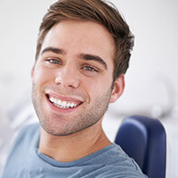 Man in dental chair smiling jovially