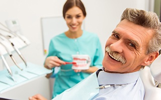 Montgomery Dental Services Man with stylish stache smiling