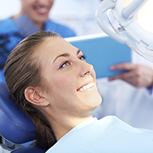 Lady laying on dental chair smiling