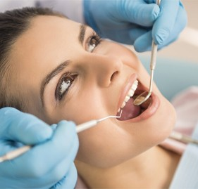 Woman during dental exam in chair