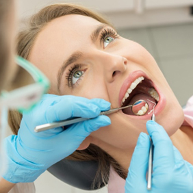 Montgomery Wisdom Tooth Extractions Lady getting mouth checked