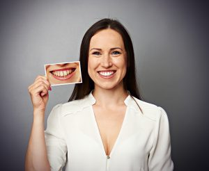 Smiling woman with improved teeth